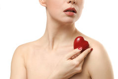 Young woman showing heart shaped candy. Face close Royalty Free Stock Images