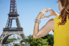 Young woman showing heart shaped hands in Paris, France Royalty Free Stock Image