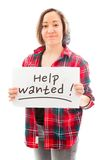 Young woman showing help wanted sign Stock Photo