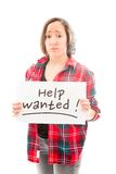 Young woman showing help wanted sign Stock Image