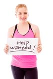 Young woman showing help wanted sign on white background Stock Images