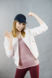 Young woman showing her arm muscles Stock Image