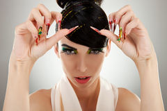 Young woman showing her big finger nails Stock Photography