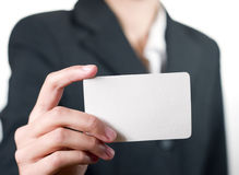 Young woman showing her business card closeup Stock Photos