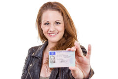 Young woman showing her driver's license Royalty Free Stock Photos