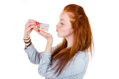 Young woman showing her driver's license. 16 to 18 year old girl just received her driver license Stock Image