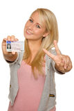 Young woman showing her driver's license. 16 to 18 year old girl just received her driver license Stock Photos