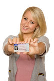 Young woman showing her driver's license. 16 to 18 year old girl just received her driver license Stock Photo