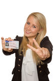Young woman showing her driver's license. 16 to 18 year old girl just received her driver license Royalty Free Stock Image