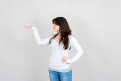 Young woman showing with her hand Royalty Free Stock Images