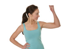 Young woman showing her muscles Stock Images