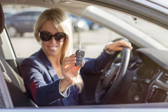 Young woman showing her new car keys Royalty Free Stock Photography