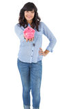 Young woman showing her piggy bank Royalty Free Stock Photography