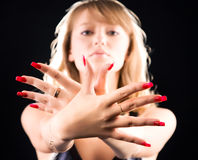 Young woman showing her red nails Stock Photos