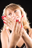 Young woman showing her red nails Stock Images