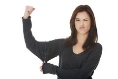 Young woman showing her strength Royalty Free Stock Images
