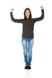 Young woman showing her strength Royalty Free Stock Image