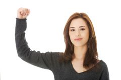 Young woman showing her strength Stock Image