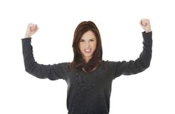 Young woman showing her strength Stock Photos