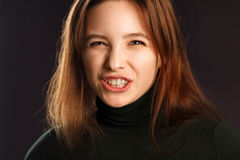 Young woman showing her teeth Stock Image