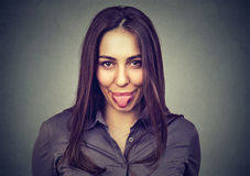 Young woman showing her tongue royalty free stock photo