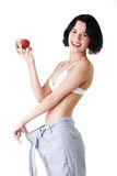 Young woman showing how much weight did she lost. Royalty Free Stock Image