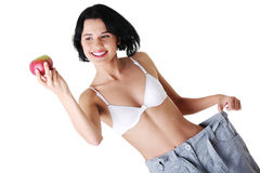 Young woman showing how much weight did she lost. Royalty Free Stock Photos