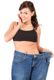 Young woman showing how much weight she lost Royalty Free Stock Photography