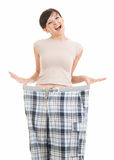 Young woman showing how much weight she lost Stock Photography