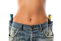 Young woman showing how much weight she lost. Royalty Free Stock Photography