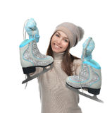 Young woman showing ice skates for winter ice skating sport acti Stock Photography