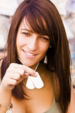 Young woman showing ID Stock Photo
