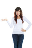 Young woman showing a imaginary product Stock Photo