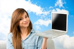 Young woman showing laptop. Royalty Free Stock Photography