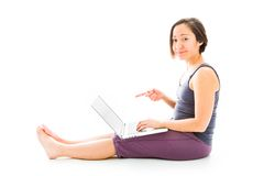 Young woman showing a laptop Royalty Free Stock Photo