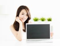 Young woman showing laptop screen. Smiling young woman showing laptop screen Stock Photos