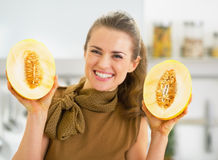 Young woman showing melon slices Stock Photography