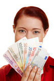 Young woman showing money fan Stock Photos