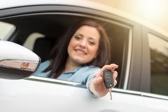 Young woman showing new car keys, light effect. Happy young woman showing new car keys, light effect Stock Images