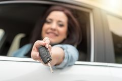 Young woman showing new car keys, light effect Stock Images