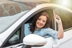 Young woman showing new car keys, light effect Royalty Free Stock Photos