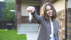 Young woman showing new house key stock video footage