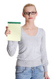 Young woman showing notepad Royalty Free Stock Photography