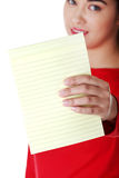 Young woman showing notepad Stock Images