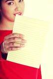 Young woman showing notepad. Young happy student woman showing blank notepad Stock Photos
