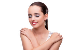 The young woman showing off her jewellery isolated on white Royalty Free Stock Photos