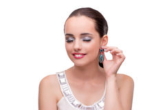The young woman showing off her jewellery isolated on white Royalty Free Stock Photography