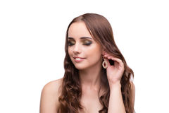The young woman showing off her jewellery isolated on white Royalty Free Stock Photo