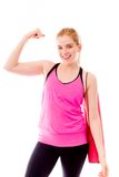 Young woman showing off her muscle Stock Photos