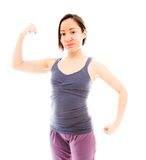 Young woman showing off her muscle Royalty Free Stock Photography